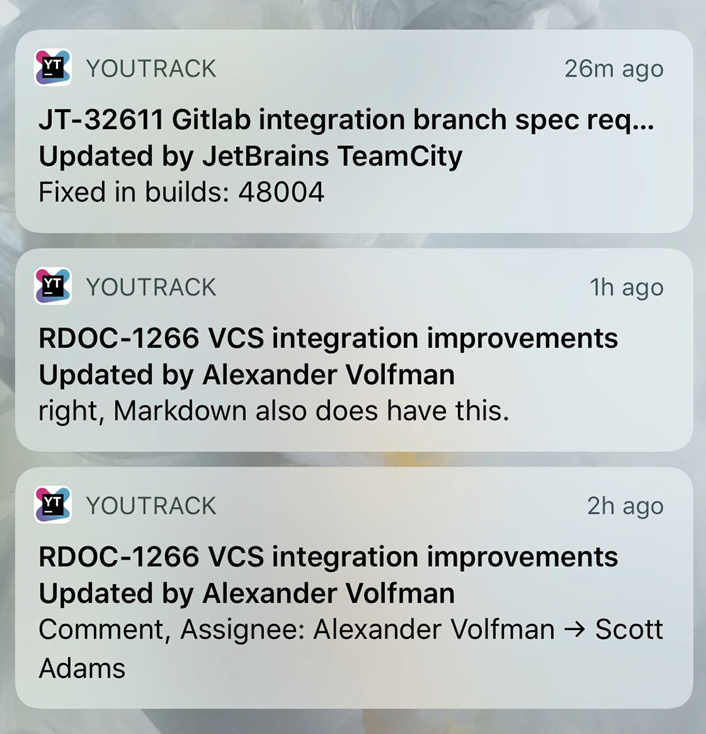 Push notifications from YouTrack Mobile on the lock screen of a mobile phone.